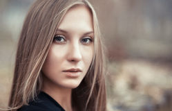 Portrait of a beautiful young woman close-up. Outdoors Stock Images