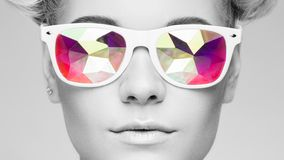 Portrait of beautiful young woman with colored glasses royalty free stock photos