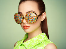 Portrait of beautiful young woman with colored glasses Royalty Free Stock Image