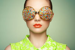 Portrait of beautiful young woman with colored glasses Royalty Free Stock Photography