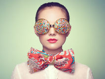 Portrait of beautiful young woman with colored glasses Stock Photos
