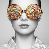 Portrait of beautiful young woman with colored glasses Stock Photography