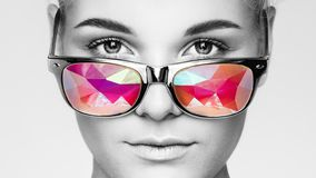 Portrait of beautiful young woman with colored glasses stock images
