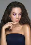 Portrait of beautiful young woman with creative makeup with glos. Sy brown hair Stock Photo