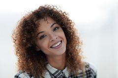 Portrait of a beautiful young woman with curly hair. Royalty Free Stock Photos