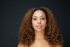 Portrait of a beautiful young woman with curly hair Stock Photos