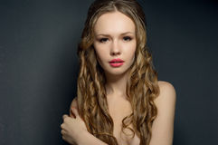Portrait of a beautiful young woman on dark background. Royalty Free Stock Image
