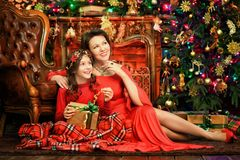 Portrait of beautiful young woman and daughter posing stock photography