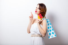 Portrait of beautiful young woman with dotted shopping bag on th. E wonderful studio background Stock Photos