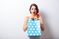 Portrait of beautiful young woman with dotted shopping bag on th Stock Photography