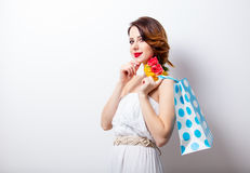 Portrait of beautiful young woman with dotted shopping bag on th Royalty Free Stock Photos