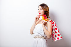 Portrait of beautiful young woman with dotted shopping bag on th Stock Images