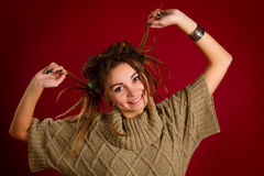 Portrait of a beautiful young woman with dreadlocks on a red Royalty Free Stock Photography