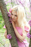 Young woman dreaming in spring park. Portrait of beautiful young woman dreaming in spring park Royalty Free Stock Photo