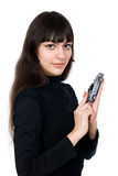 Portrait of a beautiful young woman dreaming to purchase a new c. Ar against white background Stock Photo