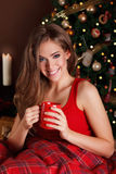Portrait of a beautiful young woman. Drinking at Christmas Royalty Free Stock Image