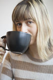 Portrait of Beautiful Young Woman with Drinking Coffee Stock Photography