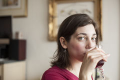 Young Woman with Beautiful Green Eyes Drinking Wine Royalty Free Stock Photos