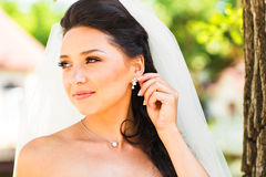 Portrait of beautiful young woman with earing. Make up and hair style. Wedding bride make up. Stock Image