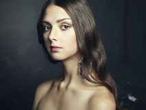 Portrait of beautiful young woman with earring Royalty Free Stock Photo