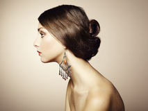 Portrait of beautiful young woman with earring Stock Photography