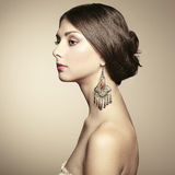 Portrait of beautiful young woman with earring Royalty Free Stock Image