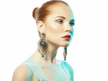 Portrait of beautiful young woman with earring Royalty Free Stock Photos