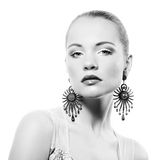 Portrait of beautiful young woman with earring Royalty Free Stock Photography