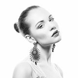 Portrait of beautiful young woman with earring Stock Photo