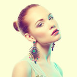 Portrait of beautiful young woman with earring Royalty Free Stock Images