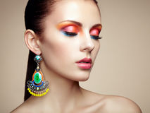 Portrait of beautiful young woman with earring. Jewelry and acce Royalty Free Stock Images