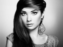 Portrait of beautiful young woman with earring. Jewelry and acce Royalty Free Stock Image