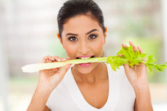 Woman eating celery Royalty Free Stock Photos