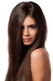 Portrait of a beautiful young woman with elegant long shiny hair Stock Photo