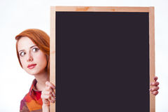 Portrait of beautiful young woman with empty board on the wonder Stock Photo