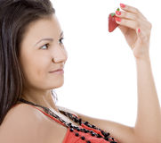 Portrait of beautiful young woman enjoy strawberry Stock Photos