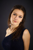 Portrait of beautiful young woman in evening dress Royalty Free Stock Image