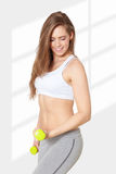 Portrait of a beautiful young woman exercising with dumbells Stock Photography