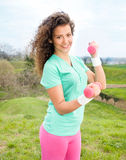Portrait of Beautiful young woman exercising with weights in the Royalty Free Stock Photo