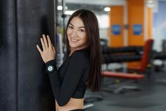 Portrait of beautiful young woman in fitness gym. Portrait of beautiful young woman in fitness gym, copy space stock image