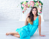 Portrait of a beautiful young woman with floral background Royalty Free Stock Photography