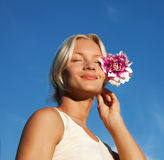 Portrait of beautiful young woman with flower Royalty Free Stock Image