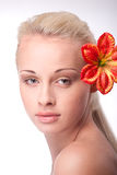 Portrait of beautiful young woman with flower Stock Photo