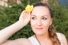 Portrait of beautiful young woman with  flower Royalty Free Stock Photo