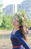 Portrait of beautiful young woman with flowers. Girl on nature. Spring flowers. Royalty Free Stock Images