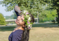 Portrait of beautiful young woman with flowers. Girl on nature. Spring flowers. Stock Photography