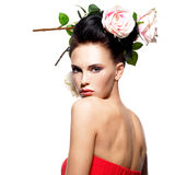 Portrait of beautiful young woman with flowers in hair. Royalty Free Stock Photos