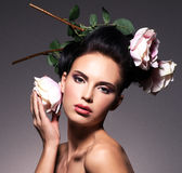 Portrait of beautiful young woman with flowers in hair. Stock Photo