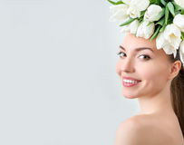 Portrait of beautiful young woman with flowers in hair Stock Photo