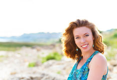 Portrait of the beautiful young woman with fluttering red hair Stock Photos